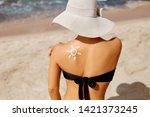 beauty woman applying sun cream ...   Shutterstock . vector #1421373245