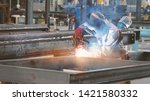 Small photo of Welding with sparks by Process fluxed cored arc welding in factory , Welding by Welder Thailand,copy space for you text