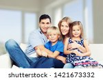 beautiful smiling family on... | Shutterstock . vector #1421673332