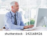doctor typing on his computer... | Shutterstock . vector #142168426