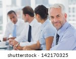 smiling businessman posing in... | Shutterstock . vector #142170325