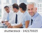 smiling businessman posing in... | Shutterstock . vector #142170325