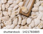 cook homemade gnocchi on the... | Shutterstock . vector #1421783885