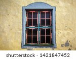 window with a pink frame in the ... | Shutterstock . vector #1421847452