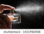 spraying perfume on dark...   Shutterstock . vector #1421983508