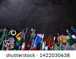 school supplies on blackboard... | Shutterstock . vector #1422030638