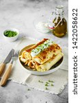tasty stuffed pancakes crepes...   Shutterstock . vector #1422058622