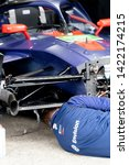 Small photo of Berlin, Germany - May 25, 2019: Mechanic at work checking a Envision Virgin Racing car, partner of the digital energy company Envision Group, during the ABB FIA Formula E street racing Championship