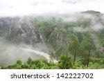 fog after rain in wild forest ... | Shutterstock . vector #142222702