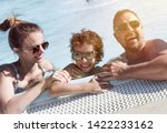happy family in the pool ... | Shutterstock . vector #1422233162