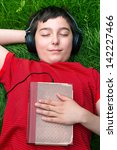 boy is lying on a grass and he... | Shutterstock . vector #142227466