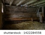 Empty Cow Shed With Hay On...