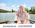 vital senior man in rowboat on... | Shutterstock . vector #1422403505