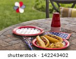 hot dogs at a july 4th cookout... | Shutterstock . vector #142243402