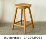 Wooden stool in natural color...