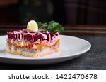 Stock photo herring salad under a fur coat with crabs on a white plate layered salad with herring beets 1422470678