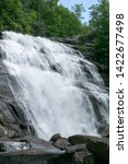 Waterfall in forest, Rainbow Falls, Lake Toxaway in Blue Ridge Mountains North Carolina.