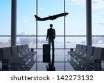 Man In Airport And Airplane In...