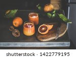 two glasses of freshly squeezed ... | Shutterstock . vector #1422779195