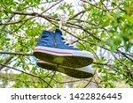 Old Worn Blue Sport Boots...