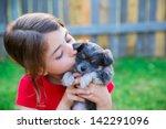 children girl kissing her puppy ... | Shutterstock . vector #142291096