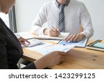 managers and accountants have... | Shutterstock . vector #1423299125