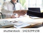 both businessmen have achieved... | Shutterstock . vector #1423299158