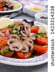 salad with octopus and fresh... | Shutterstock . vector #1423314338