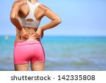 back pain. athletic woman in... | Shutterstock . vector #142335808