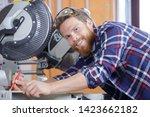 happy workman cutting wooden... | Shutterstock . vector #1423662182