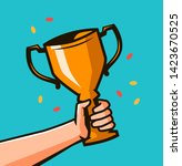 hand holding winner's trophy...   Shutterstock .eps vector #1423670525