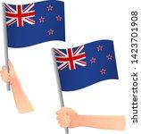 new zealand flag in hand.... | Shutterstock .eps vector #1423701908