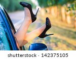 Woman's Legs In High Heel Shoe...