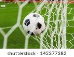 soccer football in goal net...   Shutterstock . vector #142377382