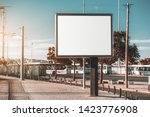 Small photo of Mockup of a big blank information poster in urban settings near the transport node; an empty horizontal street banner template; an outdoor billboard placeholder mock-up on the pavement near the road