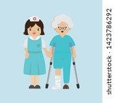 nurse helping senior patient... | Shutterstock .eps vector #1423786292