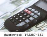 a few euros and a calculator on ... | Shutterstock . vector #1423874852