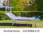 empty sunbed in the park. | Shutterstock . vector #1424086115