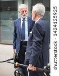 two senior gray haired... | Shutterstock . vector #1424125925