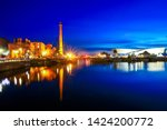 the royal albert dock is a... | Shutterstock . vector #1424200772