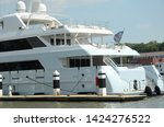 luxury yachts are docked at a... | Shutterstock . vector #1424276522