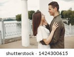 cute couple in a city. lady in... | Shutterstock . vector #1424300615