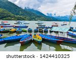 colorful boats docked on the... | Shutterstock . vector #1424410325