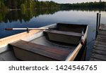 a rowboat tied to a dock on a... | Shutterstock . vector #1424546765