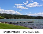 dock on a quiet lake | Shutterstock . vector #1424630138