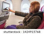 woman touching lcd... | Shutterstock . vector #1424915768