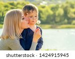 beautiful mother and her cute...   Shutterstock . vector #1424915945