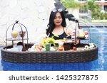 poolside breakfast asian woman...   Shutterstock . vector #1425327875
