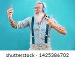 Senior Hipster Man Using...