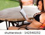 beautiful girl in a bikini... | Shutterstock . vector #142540252